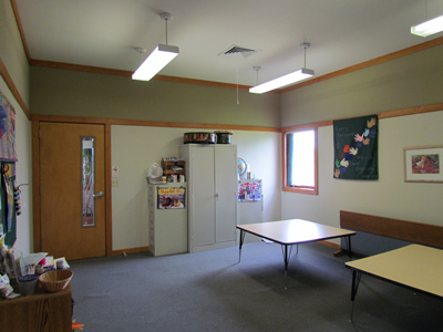 Our Alcott Room is one of our 6 classrooms and has two doors, one that opens to the Commons area, and the other which opens to the Restroom Area.