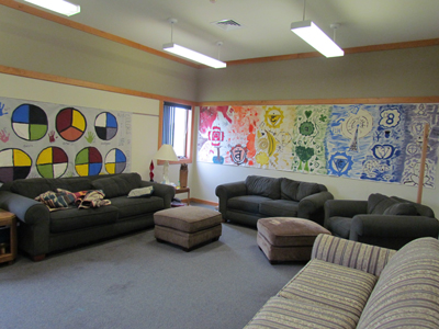 Our Channing Room is one of our 6 classrooms, where typically our Senior Youth meet. As such, it features several comfy couches, chairs, and ottomans.