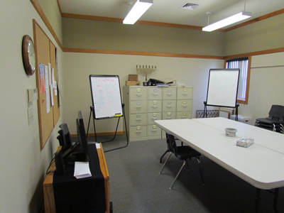 Our Fuller Room is one of our 6 classrooms, with tables and chairs.