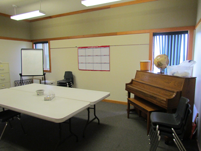 Our Fuller Room also contains a standing piano.