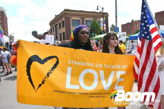ALUUC marching in the 2018 Springfield Pridefest Parade with our Standing on the Side of Love Banner. Courtesy of Boom Studios.