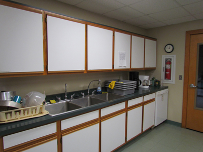 Our Kitchen features a regular dishwasher, and three sinks for scrubbing, sanitizing and rinsing. We also have a garbage disposal in the far right sink.